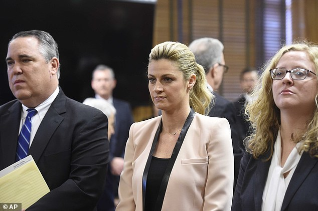 Sportscaster and TV host Erin Andrews, center, attends a hearing in Nashville, Tenn., Tuesday, Feb. 23, 2016. Andrews has filed a $75 million lawsuit against the franchise owner and manager of a luxury hotel and a man who admitted to making secret nude recordings of her in 2008. An attorney for Andrews told the jury Tuesday that Andrews felt horror, shame and humiliation when she discovered that someone had secretly filmed her nude and posted the video on the Internet. (Samuel M. Simpkins/The Tennessean via AP) NO SALES; MANDATORY CREDIT